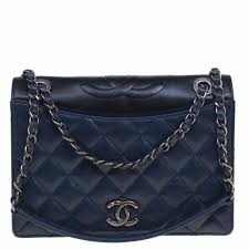 the most distinctive feature of the chanel flap bag is the tufted diamond design that sits beautifully on the leather surface even the chain strap stands