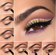 gold and purple with thick eyeliner