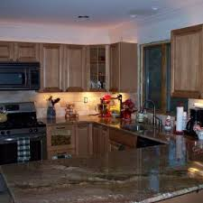 elegant quartz granite countertop with kraus sinks and brizo faucets plus oak kitchen cabinets with under elegant tile backsplash designs cabinet lighting backsplash home design