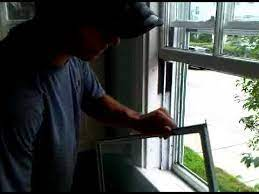 putting a storm window back together