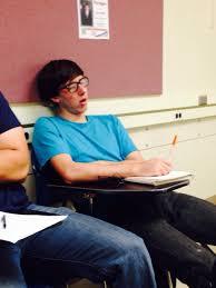 he falls asleep like this in class every day with the pen just like that he wakes up imately jots down notes then falls asleep again