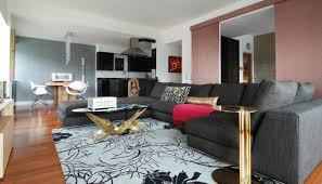 sectional sleeper sofa queen pink throw gold side table glass coffee table patterned area rug throw