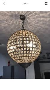 glass metal and wire globe light pendant