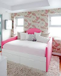 pink and white girl s bedroom featuring a hot pink daybed with drawers accented with a curved headboard