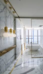 Glass Sliding Walls Alluring Bathroom With Marble Walls Also Gold Lights Glass Sliding