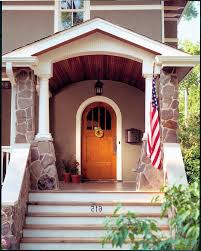 arched front doorArched front door entry craftsman with wood paneling brown stucco