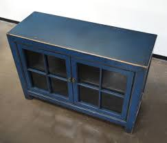 small blue cabinet with glass doors na042