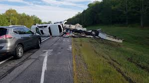NH couple avoids serious injury after truck, camper roll over on I ...
