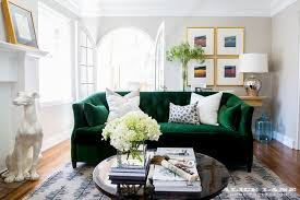 emerald green velvet sofa with black coffee table