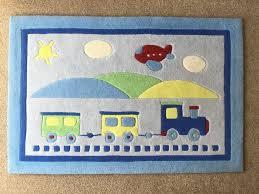 gltc aeroplane and train rug for a nursery