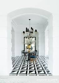 foyer with black and white triangle tiles