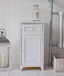 white wooden bathroom furniture. A Crisp White Freestanding Bathroom Storage Furniture. Narrow Cabinet With One Drawer And Wooden Furniture