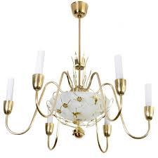 scandinavian modern brass six arm chandelier with birds and flowers for