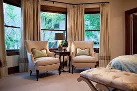 two chairs and side table with lamp Bay window curtains and ...