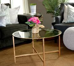 modern ikea round glass coffee table set in front of black living room sofas with decorative white fl pillows hang out time ideas rabelapp slate square