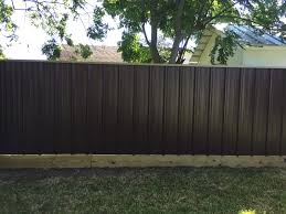 image of installing corrugated metal fence