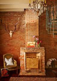 rustic exposed brick fireplace mantel and wall   Logan Killan Design