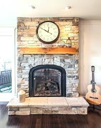 stone fireplace with rustic wood mantel wood mantel on stone fireplace cultured stone living room transitional