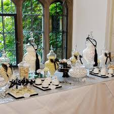 black white and silver chanel inspired dessert and sweet table
