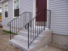 Wrought Iron Handrails for Stairs plus wooden siding and brown front door  for exterior design ideas