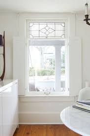 white shaker style interior shutters in heritage home
