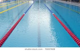 outdoor swimming pool with clearly marked lanes for peions