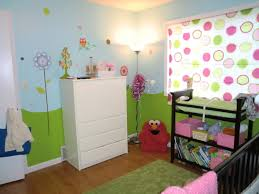 tips to design a baby room inspiring baby room decoration using black crib and shelf