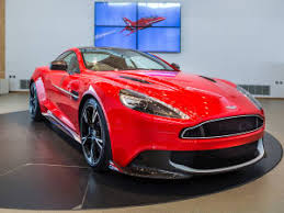 aston martin vanquish red interior. new owners at a personalised and exclusive event that will include look behind the scenes of both aston martin world famous acrobatic team vanquish red interior q