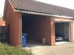 i curly have a single garage and single brick built car port next to my house which i am thinking of converting into a double garage