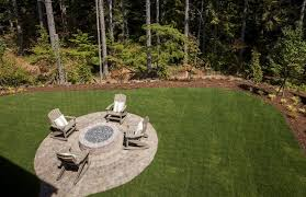 traditional patio with rumblestone round fire pit kit in cafe pathway