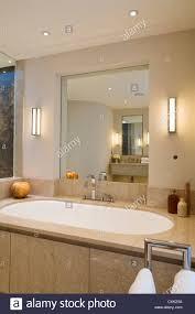 bathtub lighting. Colour Interior Bathroom Lit Light Reflection Marble Neutral Candle Mirror Bathtub Tap Fitting Toiletries Classic Contemporary Lighting F