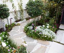 this picture perfect courtyard garden is small in size but for garden design ideas nz