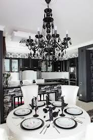 a modern black glam chandelier with black crystals is a fresh take on a traditional vintage