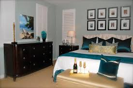 traditional bedroom ideas. Sage Green Wall Color With Teal Satin Toss Pillows For Traditional Bedroom Ideas Wooden Dresser Design O
