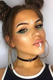 patterns done in white face paint decorating the lips and forehead of a young