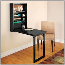 A collapsible wall mounted desk.
