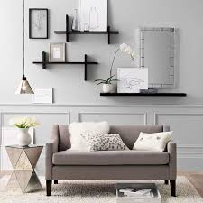 creative modular wall decorating ideas overlooking with fancy mirrored end table and book tray