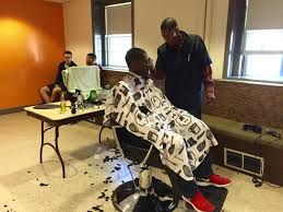 a dartmouth student gets his monthly haircut from sean taylor in the bat of a dartmouth dorm the college has contracted taylor