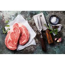 a ribeye steak is ready to be cooked