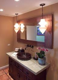 hanging heavy mirror on drywall tropical bathroom and bathroom mirror ceiling lighting container plants framed mirror granite countertops orchid pendant