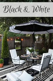 white striped patio umbrella: designing an outdoor dining area in black and white can create an elegant look