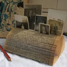 reuse old books recycled diy photo holder picture frame folding pages vine decor idea