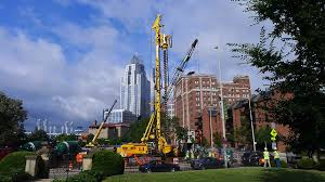 tall buildings and construction machinery