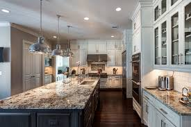 light granite kitchen traditional with white kitchen cabinets traditional kitchen islands and carts