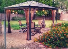 my friend melody pumped up the appeal of the patio and outdoor grill with a simple prefabricated gazebo frame that she added lights a chandelier and cozy