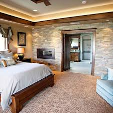 love the stone wall fireplace wood trim and accent lighting near the ceiling needs some more color or a patterned comfortor in my opinion by delia on ceiling accent lighting