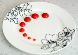 A Plate Decorated With Strawberry Coulis