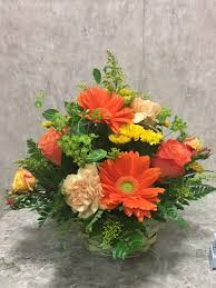 basket of color by exceptional flowers gifts