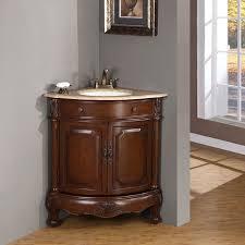 antique corner bathroom cabinet with sink under gold framed picture on laminate bathroom floor