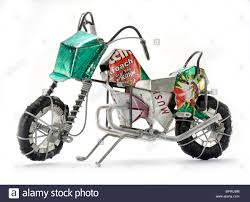 a toy motorcycle handmade in cape town by an african using tin